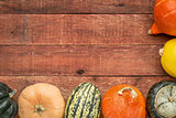 red barn wood background with squash