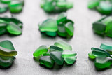 green pieces of glass polished by the sea
