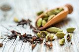 Dry beans cardamom and clove buds.