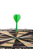 green Dart hitting the middle of dartboard