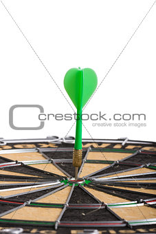 green Dart hitting the middle of dartboard