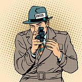 Journalist takes on retro camera. Paparazzi snooping tabloid pre