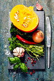 Pumpkin soup ingredients on wooden background