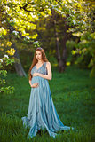 Young  pregnant woman relaxing and enjoying life in nature
