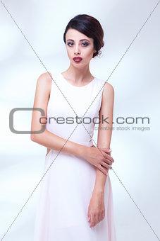 portrait of beauty woman in white dress