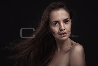 Beautiful woman with long hair and freckles