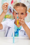 Little girl experimenting in chemistry class