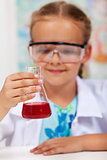 Little girl in elementary school chemistry class