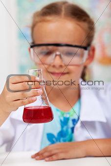 Little girl in elementary school chemistry class