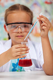 Young student in chemistry class doing an experiment