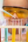 Young student in chemistry class - closeup on test tubes