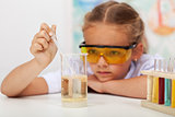 Little girl in chemistry class
