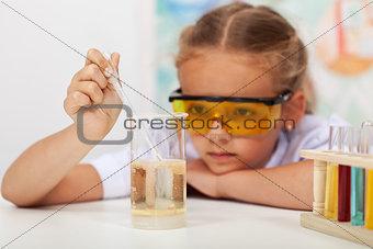 Little girl in chemistry class