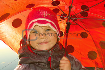 Positive girl with umbrella