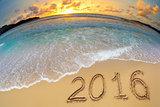2016 new year digits written on beach sand