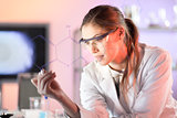 Life science researcher working in laboratory.