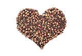 Mixed peppercorns in a heart shape