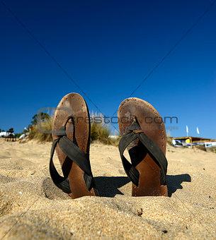 slypers on the beach