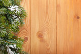 Wood texture with snow firtree christmas