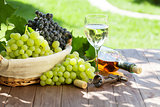 Wine and grape on garden table