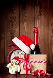 Christmas gift box, alarm clock and champagne