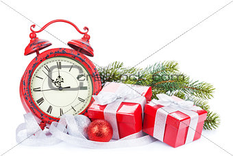Christmas clock, gift boxes and snow fir tree