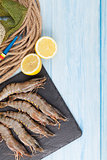 Fresh raw tiger prawns and fishing equipment