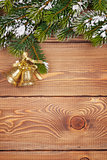 Christmas fir tree with snow and holiday decor on rustic wooden