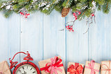 Christmas background with tree, alarm clock and gifts