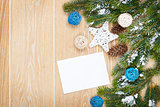 Christmas greeting card or photo frame over wooden table with sn