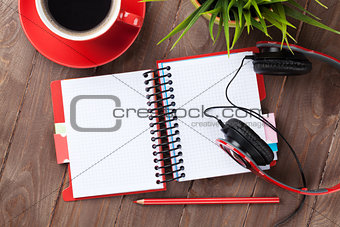 Blank notepad, headphones and coffee