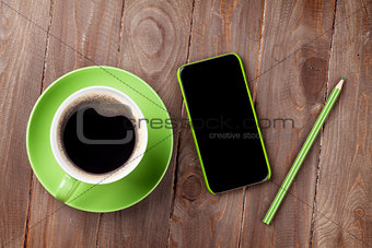 Smartphone and green coffee cup
