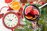 Christmas mulled wine and alarm clock on wooden table
