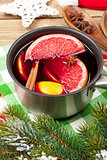 Christmas mulled wine on wooden table