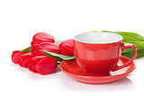Fresh red tulips with coffee cup