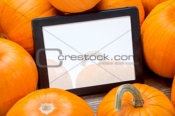 blank digital tablet with pumpkins