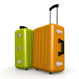 Orange and green luggages stand on the floor