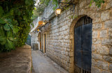 Budva old town street with shine lanterns