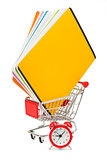 Shopping cart with copybooks and alarm clock