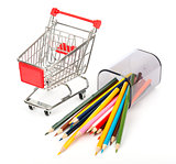 Shopping cart with crayons on white