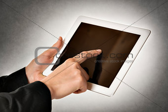 business woman points tablet computer