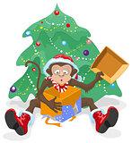 Monkey opened the box with gifts. Monkey symbol 2016