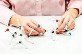 Student assembling molecule models
