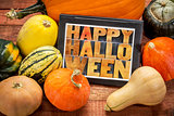 Happy Halloween on tablet with squash