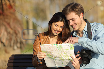 Tourists searching in a map outdoors