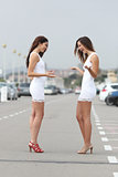 Happy women wearing the same dress