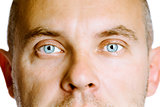 blue-eyed man. The face close up. Studio. isolated