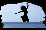 Silhouette of a woman jumping on the beach