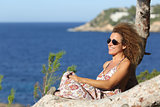 Tourist woman relaxing on the beach in vacations