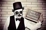 man with calaveras makeup, with chalkboard with text have a deat